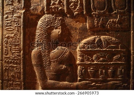 Hieroglyphic drawings and paintings on the wall of the corridor of the ancient Egyptian temple of Dendera - stock photo