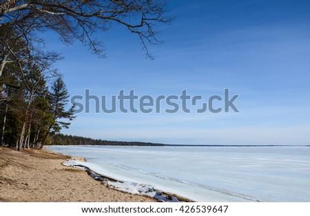 HIGGINS LAKE, MI - FEBRUARY 27:  Higgins Lake, shown here on February 27, 2016, is the tenth largest lake in Michigan. - stock photo