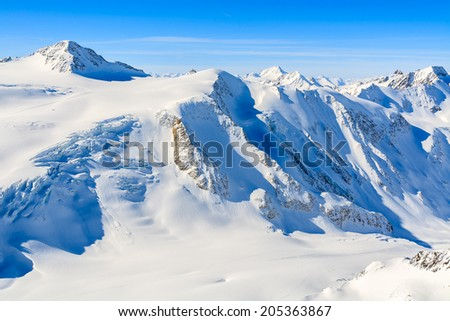 High alpine peaks covered with snow in ski resort of Pitztal, Austrian Alps  - stock photo