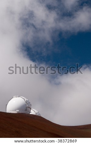 High altitude Keck telescopes and astronomy observatories atop the summit of Mauna Kea volcano, Big Island, Hawaii - stock photo