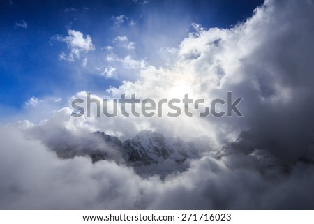 High altitude mountain scenery in Himalaya, with dramatic clouds - stock photo