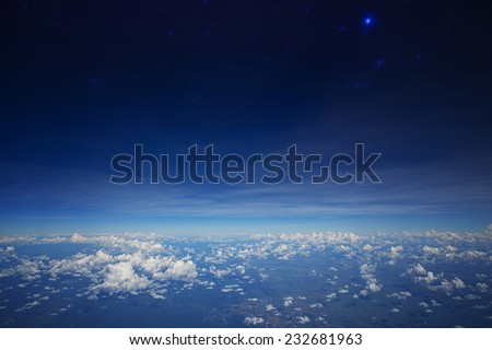 High altitude view between sky and space , in to the dark - stock photo