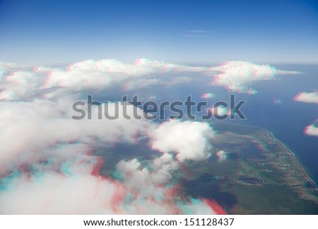 High altitude view of clouds and coastline in 3D. View anaglyph with red/cyan glasses. - stock photo