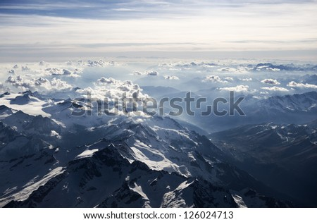 High altitude view of sunset over the mountains. The Italian Dolomites. - stock photo