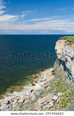 High and danger cliff coast at the Baltic sea - stock photo