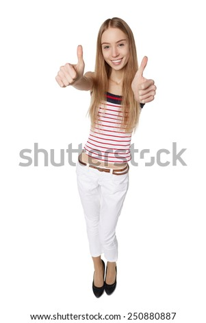 High angle perspective of a happy smiling young woman looking up at the camera giving giving a double thumbs up of success and approval isolated on white - stock photo