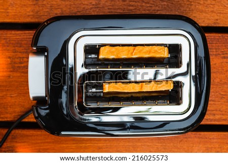 High angle picture of toaster with two sliced bread - stock photo