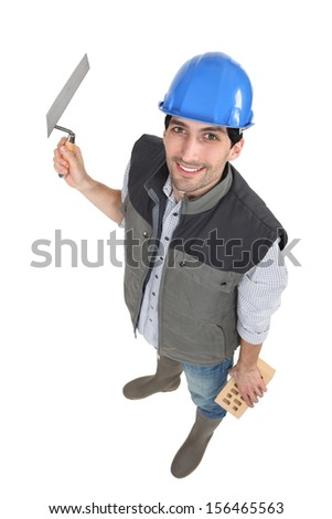 High-angle portrait of a bricklayer - stock photo