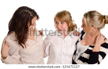 High angle portrait of three young female companions standing in a close embrace chatting or gossiping together isolated on white - stock photo