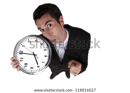 High-angle shot of a businessman holding a clock - stock photo