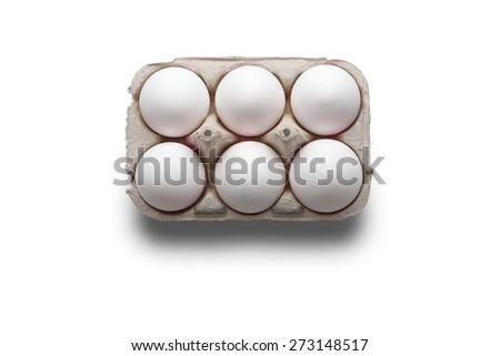 High angle studio shot of six white eggs in a box isolated on white background - stock photo