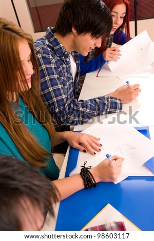 HIgh angle take of students at a desk - stock photo