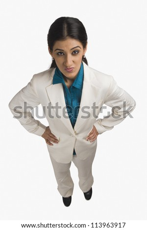 High angle view of a businesswoman making a face - stock photo