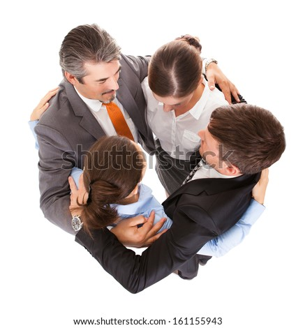 High Angle View Of Businesspeople Embracing Each Other - stock photo
