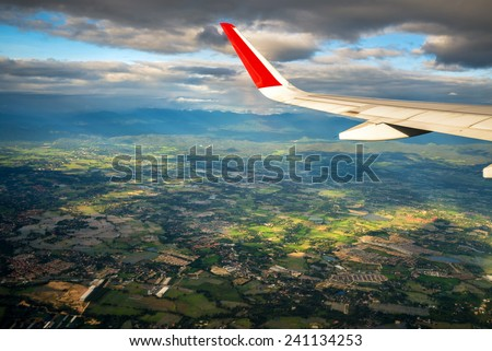high angle view of chiang mai city of thailand on the air plane - stock photo