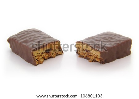 High angle view of chocolate protein bar cut in half. - stock photo