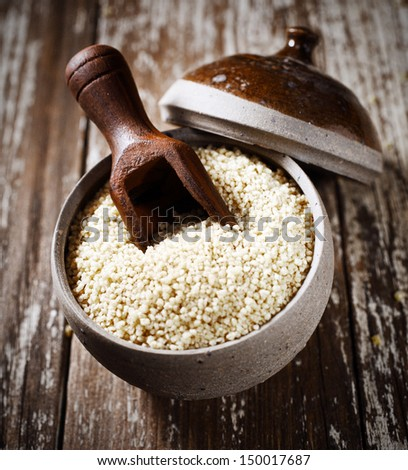 High angle view of dried quinoa seeds, a member of the goosefoot family very high in proteins and a staple ingredient in South American cuisine - stock photo