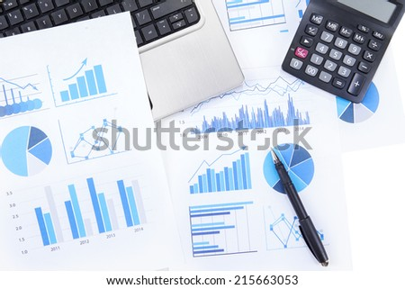 High angle view of finance chart with laptop computer, calculator, and pen - stock photo