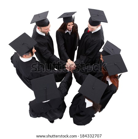High angle view of graduate students stacking hands. Isolated on white - stock photo