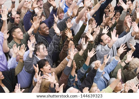 High angle view of happy multiethnic people raising hands together - stock photo
