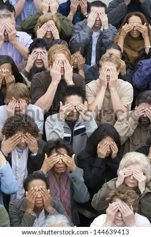 High angle view of multi ethnic people together closing there eyes - stock photo