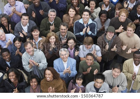 High angle view of multiethnic people clapping at rally - stock photo