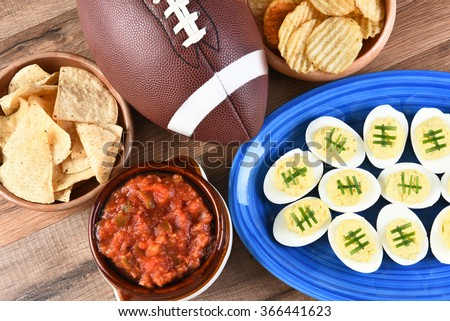 High angle view of snacks for watching a football game. Great for Super Bowl or Playoff themed projects. - stock photo