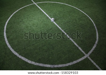 High angle view of soccer field with soccer ball on the line - stock photo