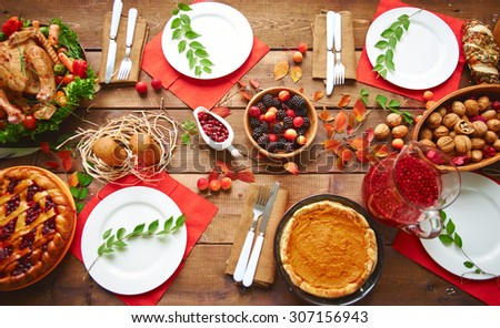 High angle view of table served for thanksgiving dinner with family - stock photo