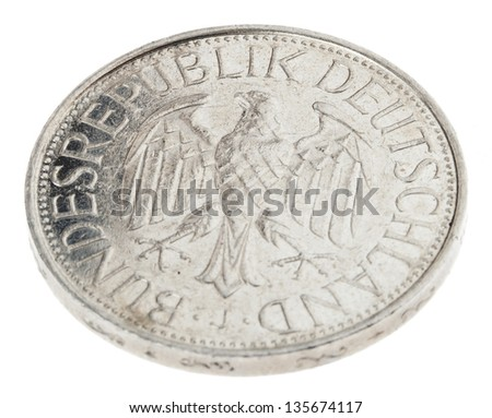 High angle view of the reverse (tails) side of a a 1 Deutsche Mark (DM) coin minted in 1989. Depicted is the German coat of arms - the German eagle. Isolated on white background. - stock photo
