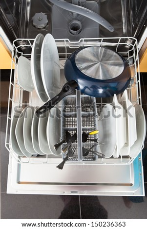 High Angle View Of Utensils In Dishwasher - stock photo