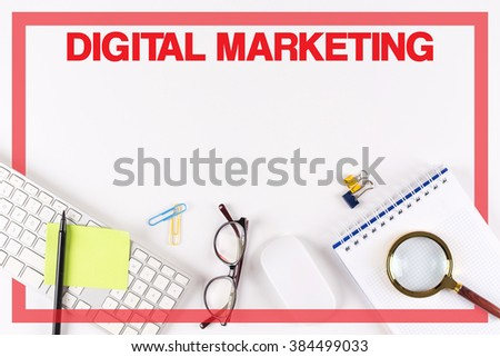 High Angle View of Various Office Supplies on Desk with a word DIGITAL MARKETING - stock photo