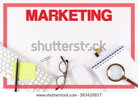 High Angle View of Various Office Supplies on Desk with a word MARKETING - stock photo