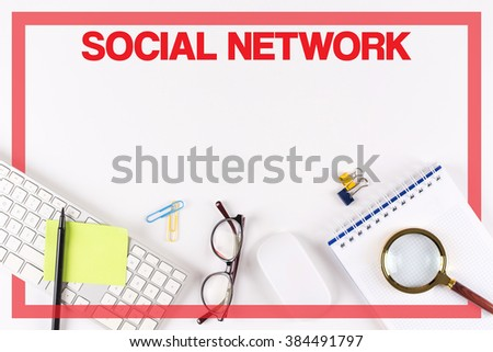 High Angle View of Various Office Supplies on Desk with a word SOCIAL NETWORK - stock photo