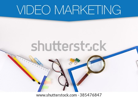 High Angle View of Various Office Supplies on Desk with a word VIDEO MARKETING - stock photo