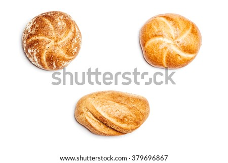 High angle view on three different bread rolls on white background, cutout isolated. - stock photo