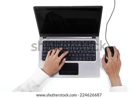 High angle view table of businessperson hands using laptop computer and mouse - stock photo