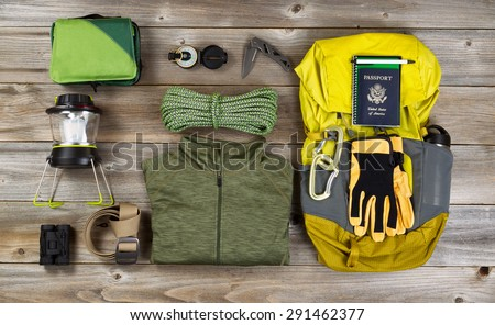High angled view of organized hiking gear for climbing placed on rustic wooden boards.  - stock photo