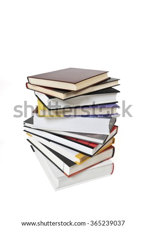 High books stack isolated on white background. Many colorful book covers. - stock photo