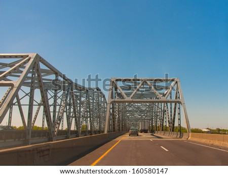 High bridge on a river - stock photo
