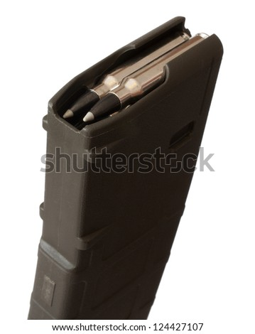 High capacity rifle magazine with bullets loaded on top - stock photo