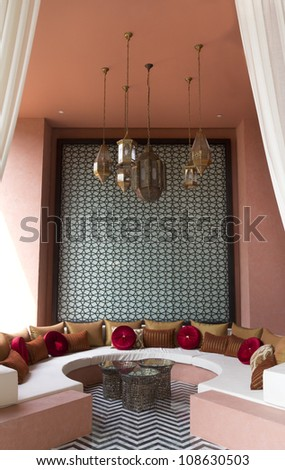 High ceiling living room with decorated lamp - stock photo