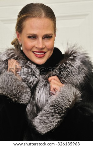 High class modern woman dressed in luxurious fur coat - stock photo