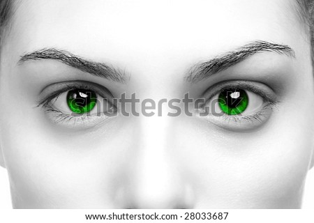 High contrast black & white close up of a womans eyes coloured green - stock photo