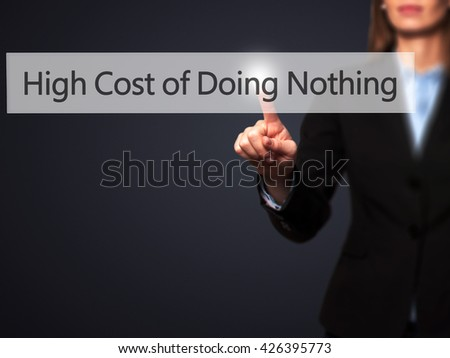 High Cost of Doing Nothing - Businesswoman hand pressing button on touch screen interface. Business, technology, internet concept. Stock Photo - stock photo
