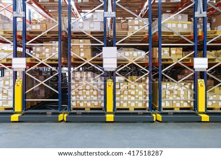High Density Storage Shelving System in Warehouse - stock photo