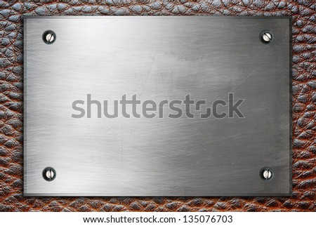 High detailed metal plate sign with screws on leather surface - stock photo