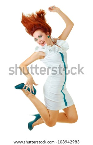 High-End Fashion Model with red hair and heels jumping in studio on white background - stock photo