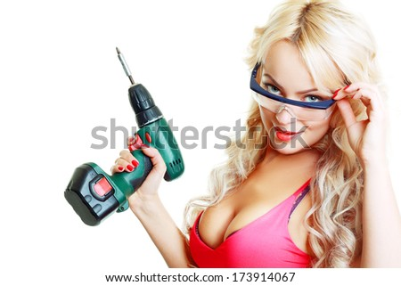 High fashion glamour blondy model in pink top looking through safe glasses - stock photo