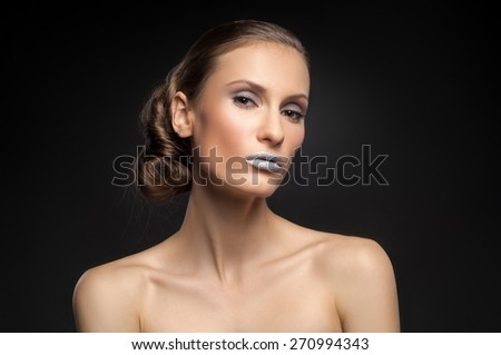 High fashion look, closeup beauty portrait of beautiful young woman model with bright makeup with perfect clean skin with colorful blue lips. Beautiful girl with elegant hairstyle. Fashion photo - stock photo